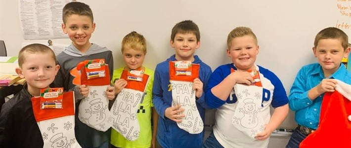 Students receive stockings for rewards at school.